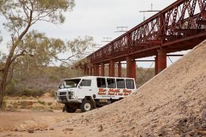 Tour bus at Algebuckina Bridge on the River Neales
